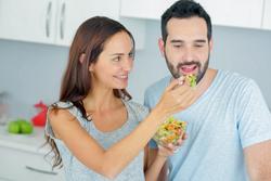 Couple sharing vegetable salad