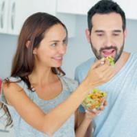 Couple sharing vegetable salad